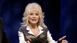 FILE - This Jan. 19, 2012 file photo shows entertainer Dolly Parton during a news conference in Nashville, Tenn.