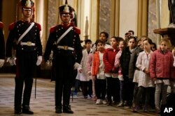 Schoolchildren look at soldiers moments before the arrival of U.S. Vice President Mike Pence at the Buenos Aires Metropolitan Cathedral in Argentina, Aug. 15, 2017. Pence participated in a wreath-laying ceremony to commemorate Jose de San Martin, an Argentine general who helped lead the revolution against Spanish rule in Argentina, Chile and Peru.