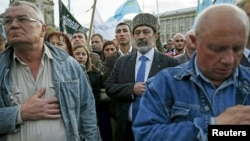 File - Crimean Tatars attend a rally marking the 71st anniversary of their mass deportation from the peninsula to distant parts of the Soviet Union, in Kyiv, Ukraine, May 2015.