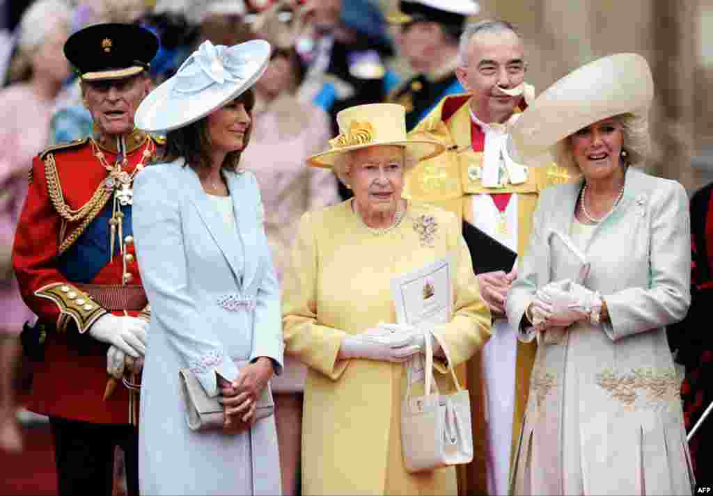 From left, Prince Phillip, Carole Middleton, Britain's Queen Elizabeth II and Camilla, Duchess of Cornwall stand outside of Westminster Abbey. (AP Photo)