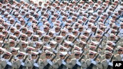 Iranian armed forces members march in a military parade, Sept. 21, 2016, marking the 36th anniversary of Iraq's 1980 invasion of Iran, in front of the shrine of late revolutionary founder Ayatollah Khomeini, just outside Tehran.