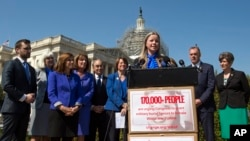 Erin Miller, granddaughter of World War Two veteran Women Airforce Service Pilots (WASP) Elaine Harmon, speaks during an event on Capitol Hill in Washington, March 16, 2016. Miller was instrumental in getting a bill passed to allow WASPs to be buried in A
