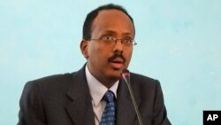 FILE - Then-Somali Prime Minister Mohamed Abdullahi Farmajo addresses officials after his swearing in ceremony at the Presidential residence in Mogadishu, Somalia.