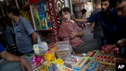 An Indian shopkeeper sells fire crackers in New Delhi, Oct. 9, 2017.
