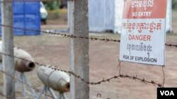 FILE PHOTO - Warning signs are seen at the Cambodian Mine Action Center in Kampong Chhnang province, Cambodia, March 31, 2017. (Sun Narin/VOA Khmer)