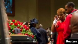 Lesley McSpadden reacts at the casket of her son Michael Brown during the funeral services at Friendly Temple Missionary Baptist Church in St. Louis, Missouri, Aug. 25, 2014.