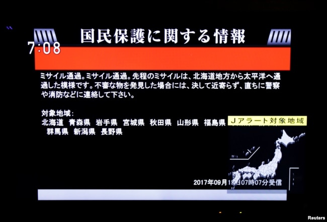 The Japanese government's alert message, called a J-alert, notifying citizens of a ballistic missile launch by North Korea is seen on a television screen in Tokyo, Sept. 15, 2017.
