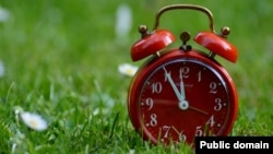 Don't forget to set your alarm clock! Pictured is an old-fashioned version. Today, most people use digital clocks or mobile phones.