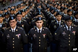 FILE - Military personnel march in the annual Veteran's Day parade in New York, Friday, Nov. 11, 2016. (AP Photo/Andres Kudacki)