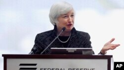 Federal Reserve Chairman Janet Yellen speaks during a conference on economic opportunity at the Federal Reserve Bank in Boston, Oct. 17, 2014.
