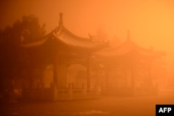 FILE - Pagodas are seen on a polluted day in Hohhot, north China's Inner Mongolia region.