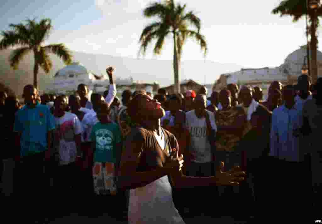 January 12: People cheer as a woman dances in front of the heavily damaged National Palace during a memorial held to commemorate victims of the 2010 earthquake, in downtown Port-au-Prince. Allison Shelley/Reuters
