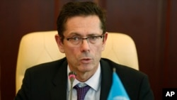 FILE - U.N. Assistant Secretary-General for Human Rights Ivan Simonovic speaks during his meeting with First Deputy Prime Minister of Crimea government Rustam Temirgaliev in Simferopol, Friday, March 21, 2014.