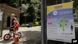 A banner explaining how the yellow fever is transmitted hangs at the entrance of a park in Sao Paulo, Brazil, Jan. 16, 2018. The World Health Organization says 35 human cases have been confirmed and hundreds more found in monkeys.