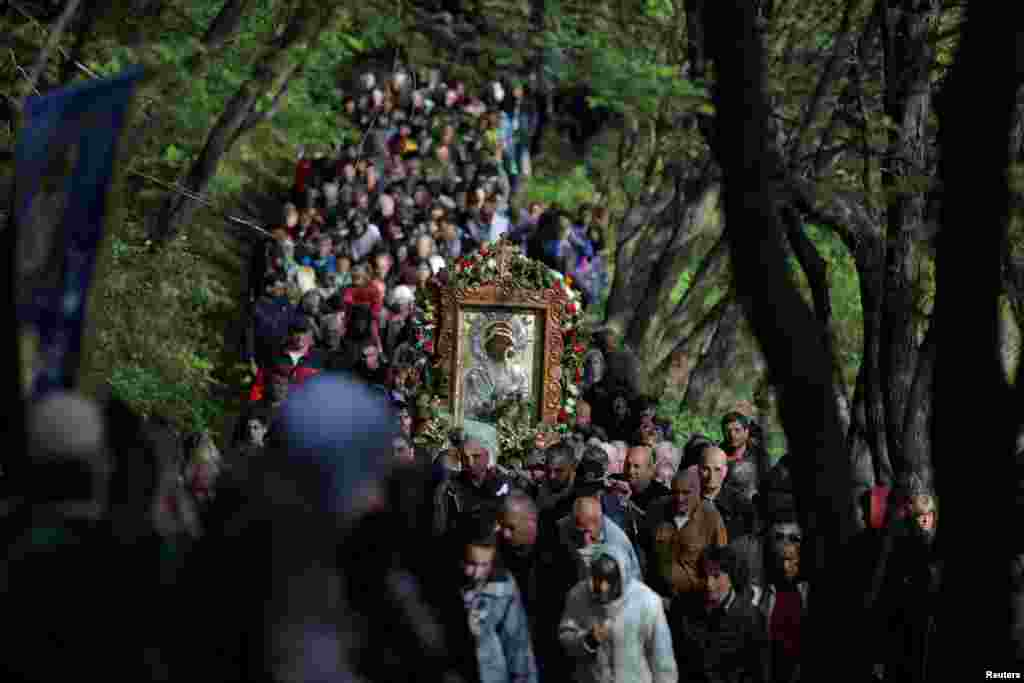 Orthodox Christians carry an icon of the Virgin Mary during a parade marking Easter near Bachkovo monastery, Bulgaria.