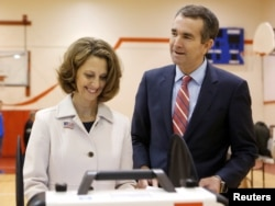 Virginia Lieutenant Governor Ralph Northam, the Democratic candidate for governor, and his wife, Pam, cast their ballots at the East Ocean View Community Center in Norfolk, Va., Nov. 7, 2017.