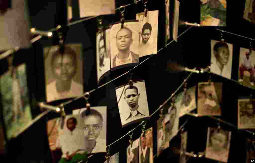 Family photographs of some of those who died hang in a display in the Kigali Genocide Memorial Centre in Kigali, April 5, 2014.
