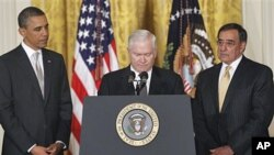 Outgoing Defense Secretary Robert Gates, center, pauses as he speaks about US troops, as President Barack Obama and Defense Secretary-nominee Leon Panetta listen, in the East Room of the White House in Washington, DC, April 28, 2011