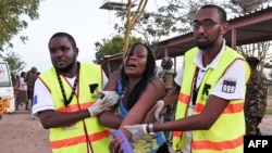 Paramedics help a student who was injured during an attack by Somalia's al-Qaida-linked al-Shabab gunmen at Garissa University College, Kenya, April 2, 2015.
