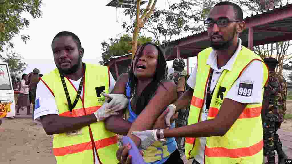 Paramedics help a student who was injured during an attack by Somalia's al-Qaida-linked al-Shabab gunmen at Garissa University College, Kenya, killing as many as 150 people. At least 147 people were killed, according to the interior minister.