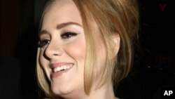 British singer Adele greets her fans after her concert at Radio City Music Hall on Nov. 17, 2015 in New York.