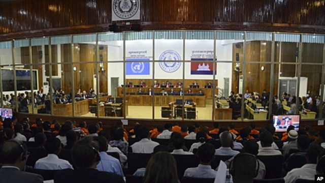 People attend a hearing for former Khmer Rouge leaders at the Extraordinary Chambers in the Courts of Cambodia (ECCC) on the outskirts of Phnom Penh, November 21, 2011.