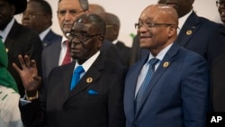 President Robert Mugabe and South African president Jacob Zuma, whose country has just sold some Zimbabwe property.