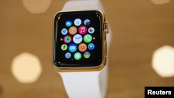 A gold plated Apple Watch is seen at an Apple Store.