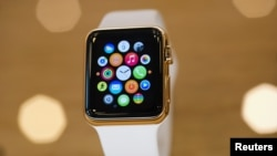 FILE - A gold-plated Apple Watch is seen at an Apple Store in Berlin, April 10, 2015.