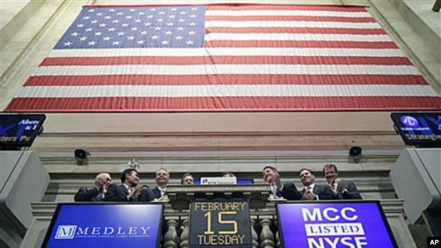 Executives with Medley Capital Corporation attend the opening bell at the New York Stock Exchange, which is being bought by Deutsche Boerse, February 15, 2011