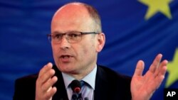 FILE- Chief Observer of EU Election Assessment Team, Thijs Berman speaks during a press conference in Kabul, April 7, 2014.