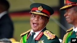 Army General Constantino Chiwenga smiles during the presidential inauguration ceremony in Harare, Zimbabwe, Nov. 24, 2017.