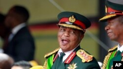 FILE: Army General Constantino Chiwenga smiles during the presidential inauguration ceremony in Harare, Zimbabwe, Nov. 24, 2017.