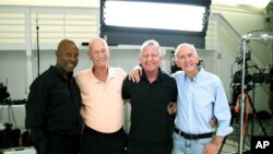 This photo shows Jessay Martin, 68, from left, Robert Reeves, 78, Michael Peterson, 65, and William Lyons, 77, in Cathedral City, Calif., in November 2020. (Ryan Yezak via AP)