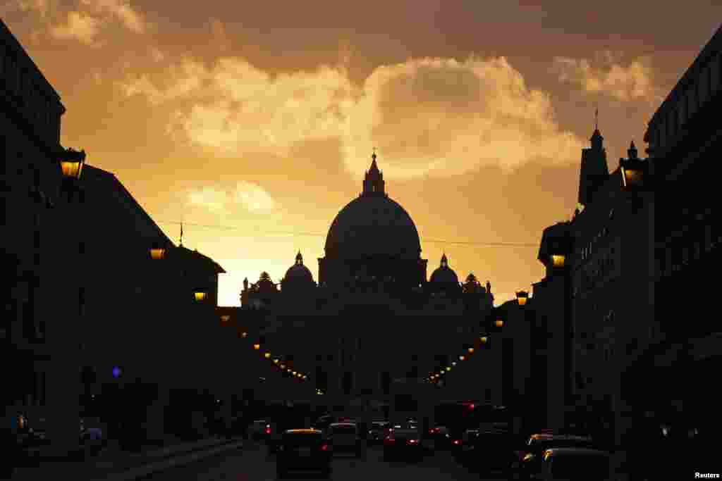 Saint Peter's Basilica at the Vatican is silhouetted during sunset in Rome, March 11, 2013.