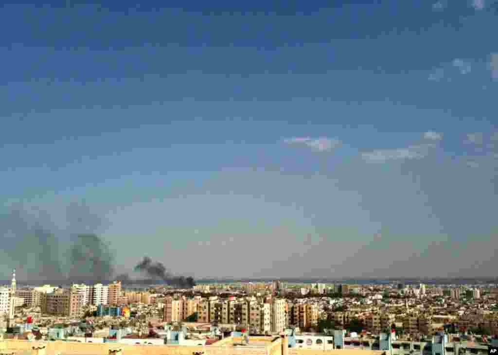 Smoke rises over the skyline in the Qaboun neighborhood of Damascus, Syria, during shelling by Syrian government forces, July 19, 2012.