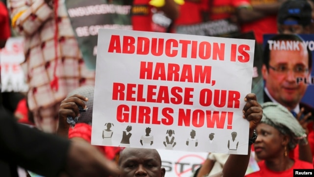 FILE - A protester calls for the release of schoolgirls abducted in April by Boko Haram.