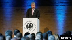 FILE - The President of the German Federal Intelligence Agency (BND) Bruno Kahl gives a speech at the 60th anniversary of the founding of the BND in Berlin, Nov. 28, 2016.