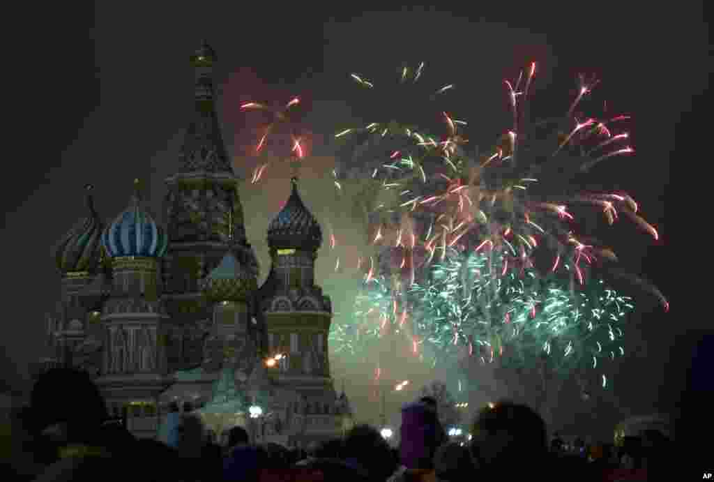Fireworks explode in the sky over St. Basil Cathedral as Russians celebrate New Year on Red Square in Moscow, Russia, on Jan. 1, 2013.