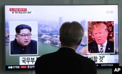 FILE - A man watches a TV screen showing file footage of U.S. President Donald Trump, right, and North Korean leader Kim Jong Un during a news program at the Seoul Railway Station in Seoul, South Korea, May 16, 2018.