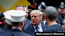 FILE: Former U.S. President Donald Trump visits the 17th Precinct of the New York City Police Department during the commemoration of the 20th anniversary of the September 11, 2001 attacks in New York City, New York, U.S., September 11, 2021. REUTERS/Mario Anzuoni