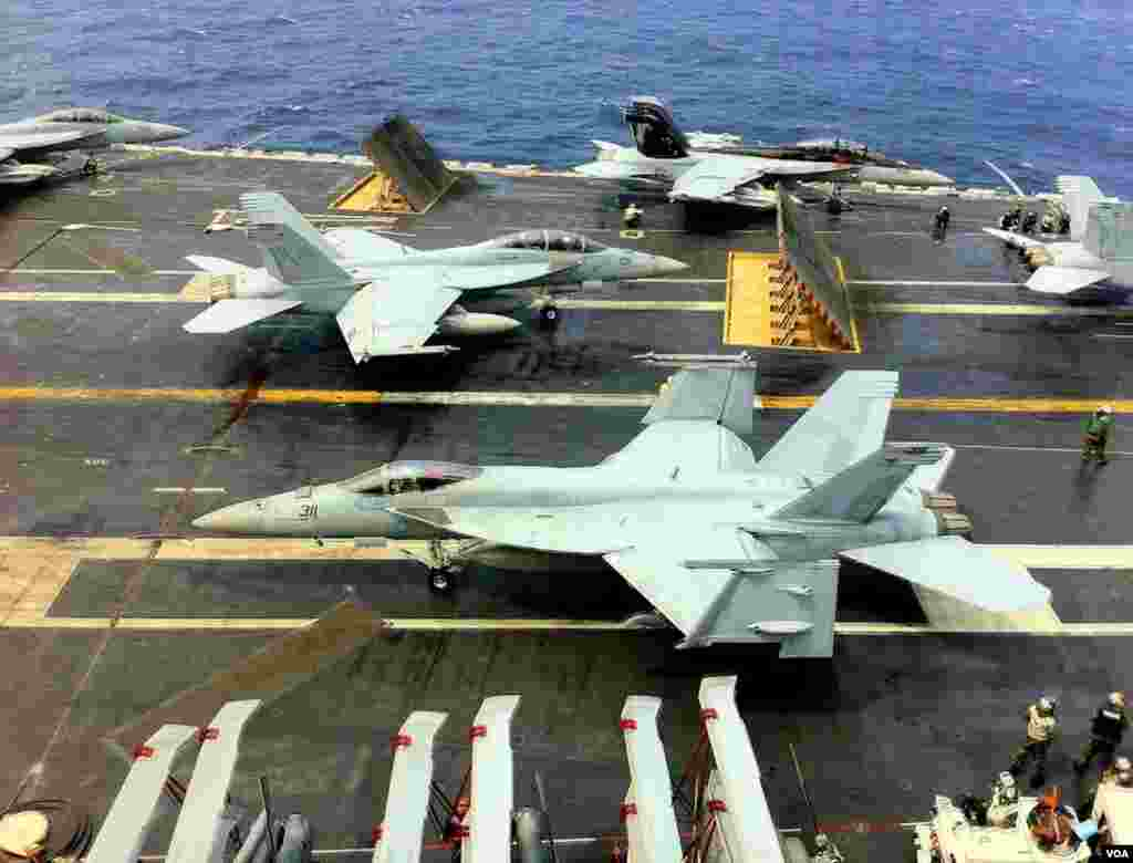 Fighter jets on the deck of the USS George Washington during joint manuevers with South Korea's navy in the Yellow Sea, June 24, 2012. (VOA/S. Herman)