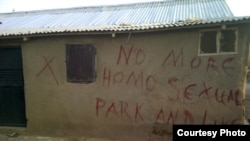 Before they destroy a building in Abuja, Nigeria, authorities mark the building with a red 'X' and write a few words.