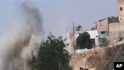 Amaterski snimak granatiranja u sirijskom gradu Homsu