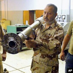 A tea towel is used as padding on an improvised rocket launcher, Benghazi, June 23, 2011