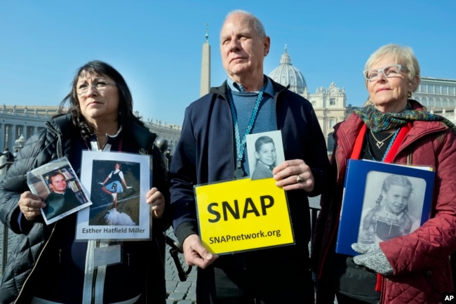Survivors Network of those Abused by Priests (SNAP) President Tim Lennon from Tucson, Ariz., center, and SNAP members Esther Hatfield Miller from Los Angeles, left, and Carol Midboe from Austin, speak to the media in St. Peter's Square, Feb. 20, 2019.