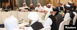 FILE - This undated handout picture shows U.S., Taliban and Qatari officials during a meeting for peace talks in Doha, Qatar. (Qatari Foreign Ministry)