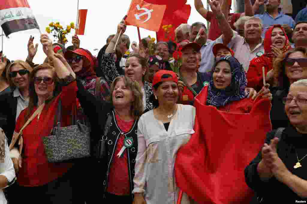 Supporters of the Iraqi Communist Party chant slogans during an International Worker's Day, or Labour Day, rally in Baghdad.