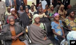 FILE - Chibok school girls, recently freed from Boko Haram captivity, are seen during a meeting with a government official in Abuja, Nigeria, Oct. 13, 2016.