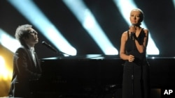 Ian Axel, left, of A Great Big World performs on stage with Christina Aguilera at the American Music Awards at the Nokia Theatre L.A. Live on Nov. 24, 2013, in Los Angeles.